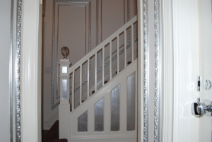 silver leaf accents on staircase